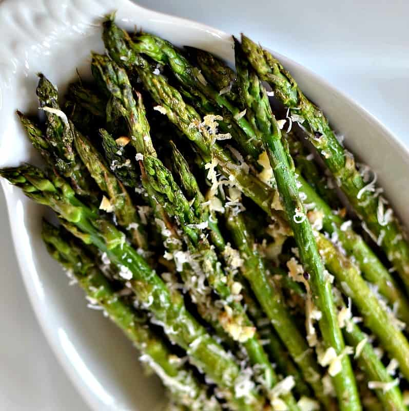 An easy vegetable side dish combining healthy asparagus, minced garlic and freshly grated Parmesan cheese.