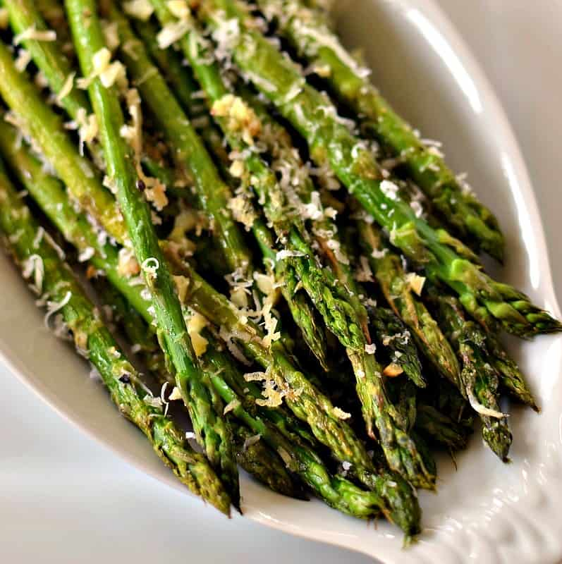 Oven Roasted Parmesan Asparagus is a quick side dish combining asparagus, minced garlic and freshly grated Parmesan Cheese.