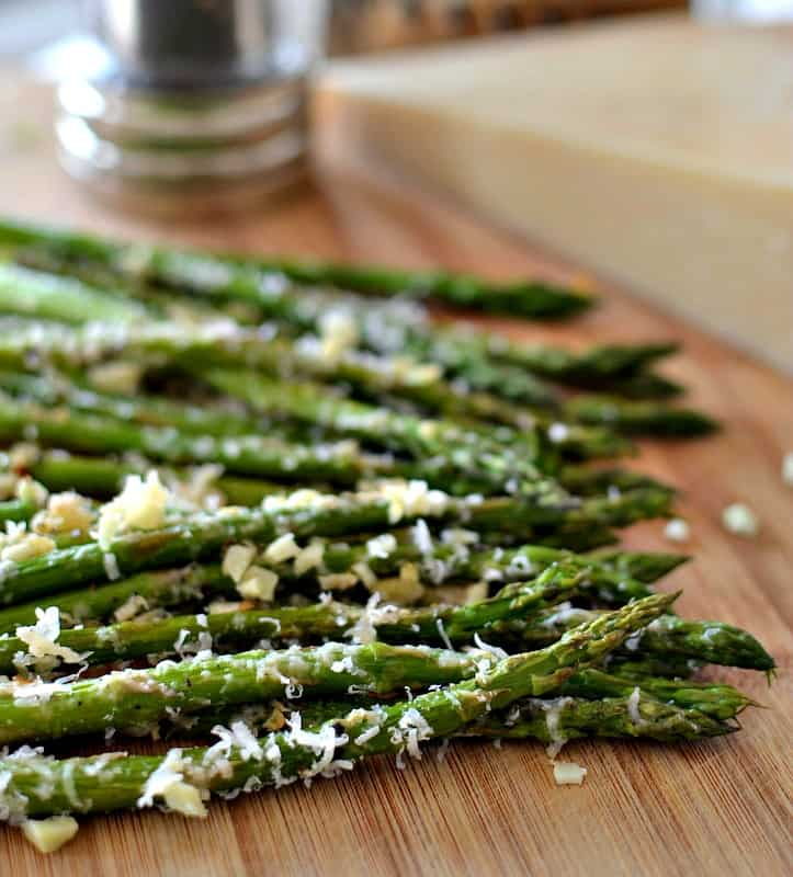 Oven Roasted Parmesan Asparagus is an easy side dish combining healthy asparagus, minced garlic and grated Parmesan Cheese.