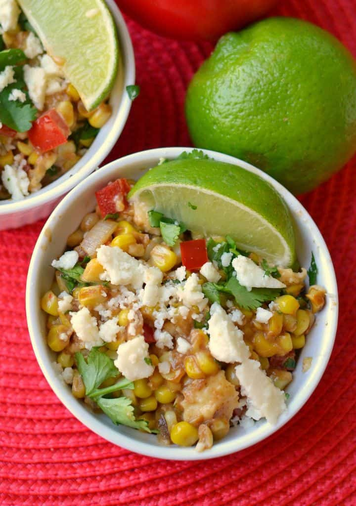 This refreshing mexican street corn salad is topped with mexican cheese and lime juice