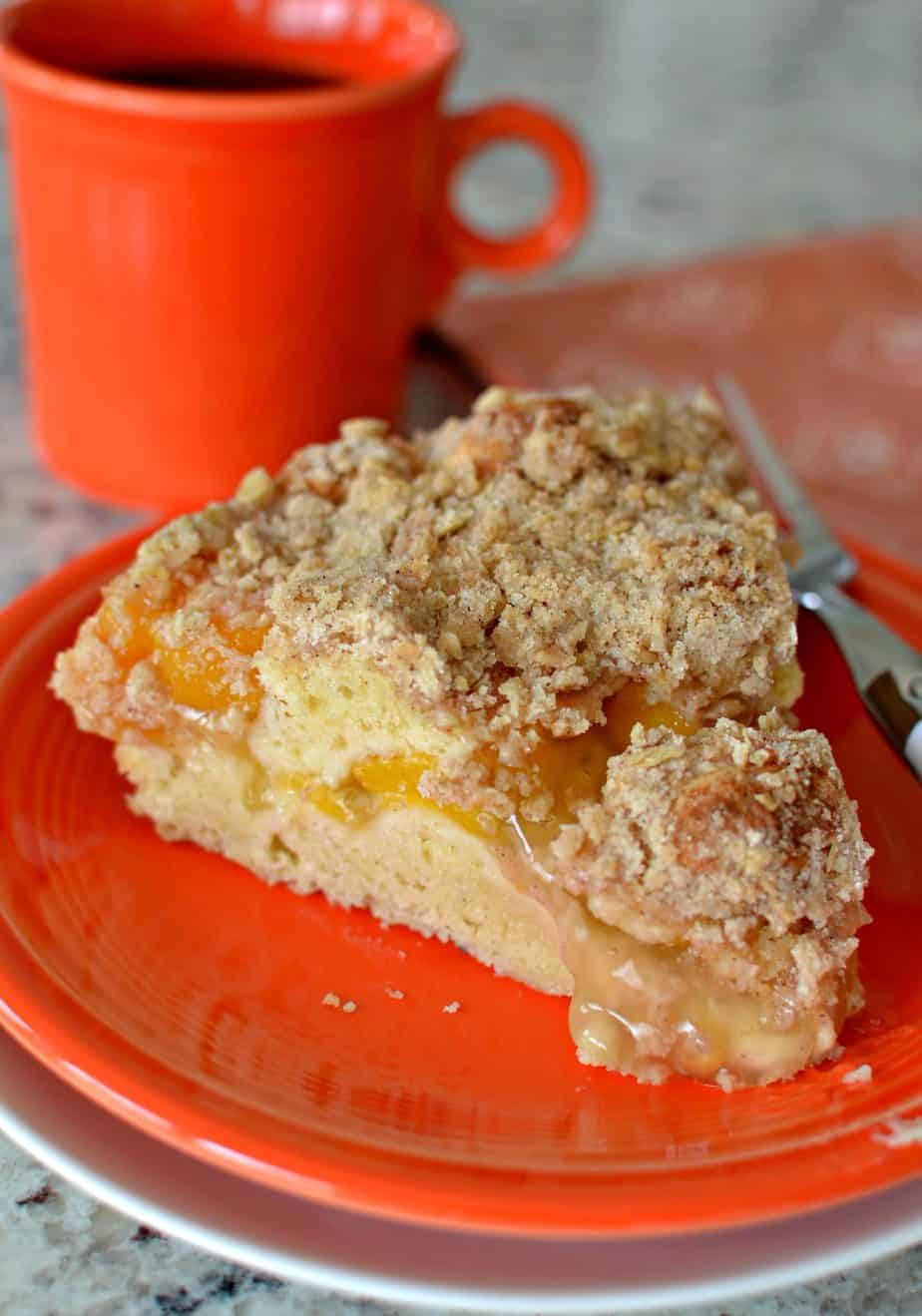 This Peach Coffee Cake has a sour cream cake base, peach center and crunchy crumb oatmeal topping.