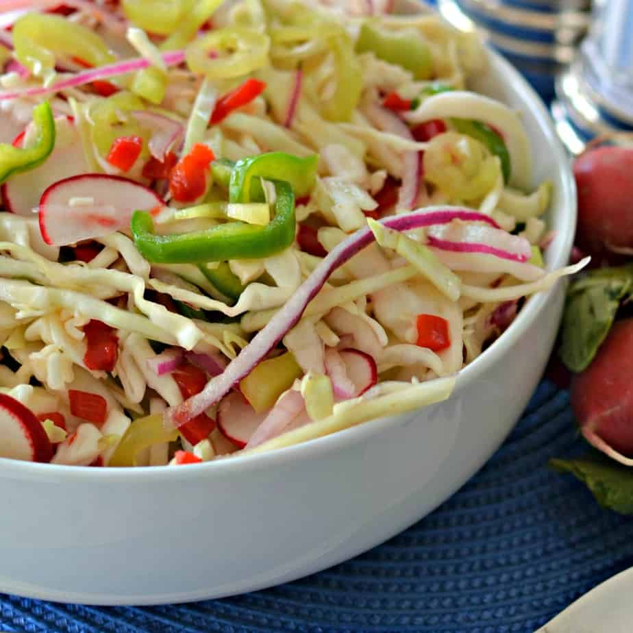 This tasty vinegar coleslaw is an easy family friendly recipe ready in fifteen minutes.