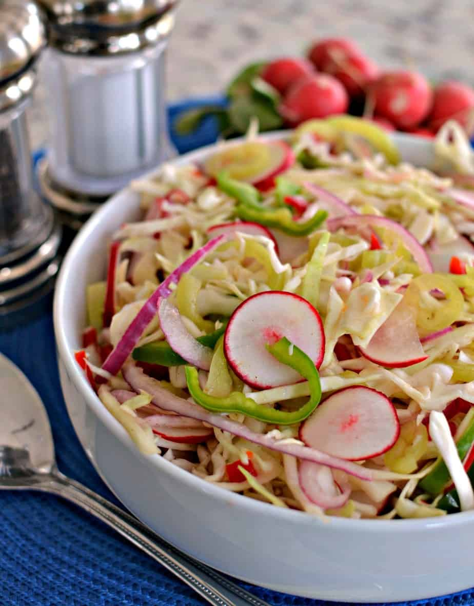 This Vinegar Coleslaw goes great with ribs, burgers, hot dogs, brats, chicken and pork.