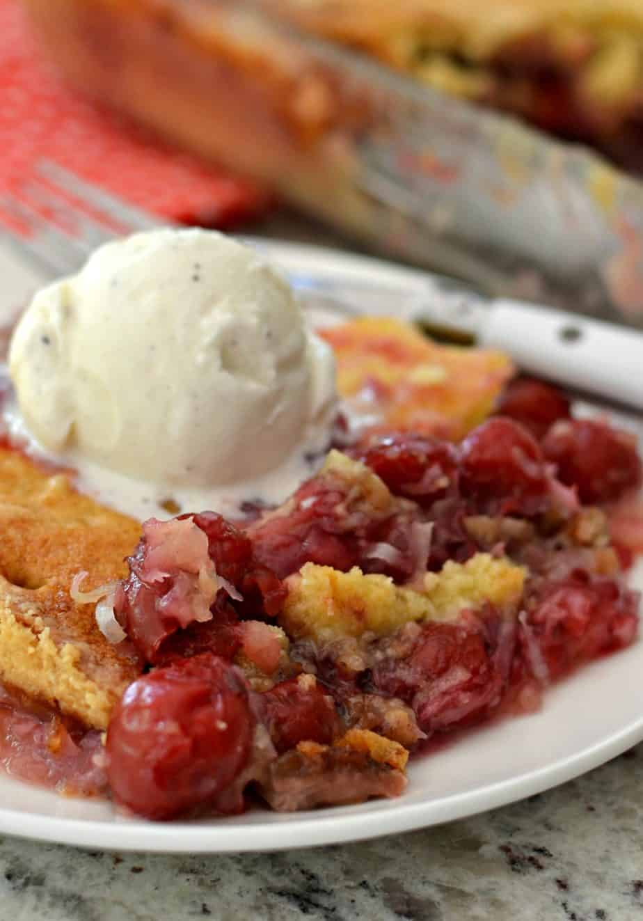 This family friendly scrumptious cherry dump cake has six easy ingredients comes together in less than ten minutes
