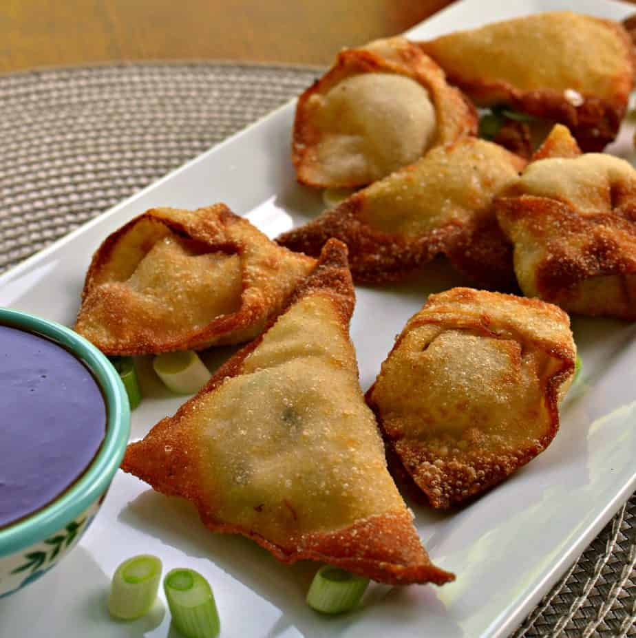 Crab Rangoon are wonton shells filled with fresh crab and cream cheese, then fried to a crispy golden brown.