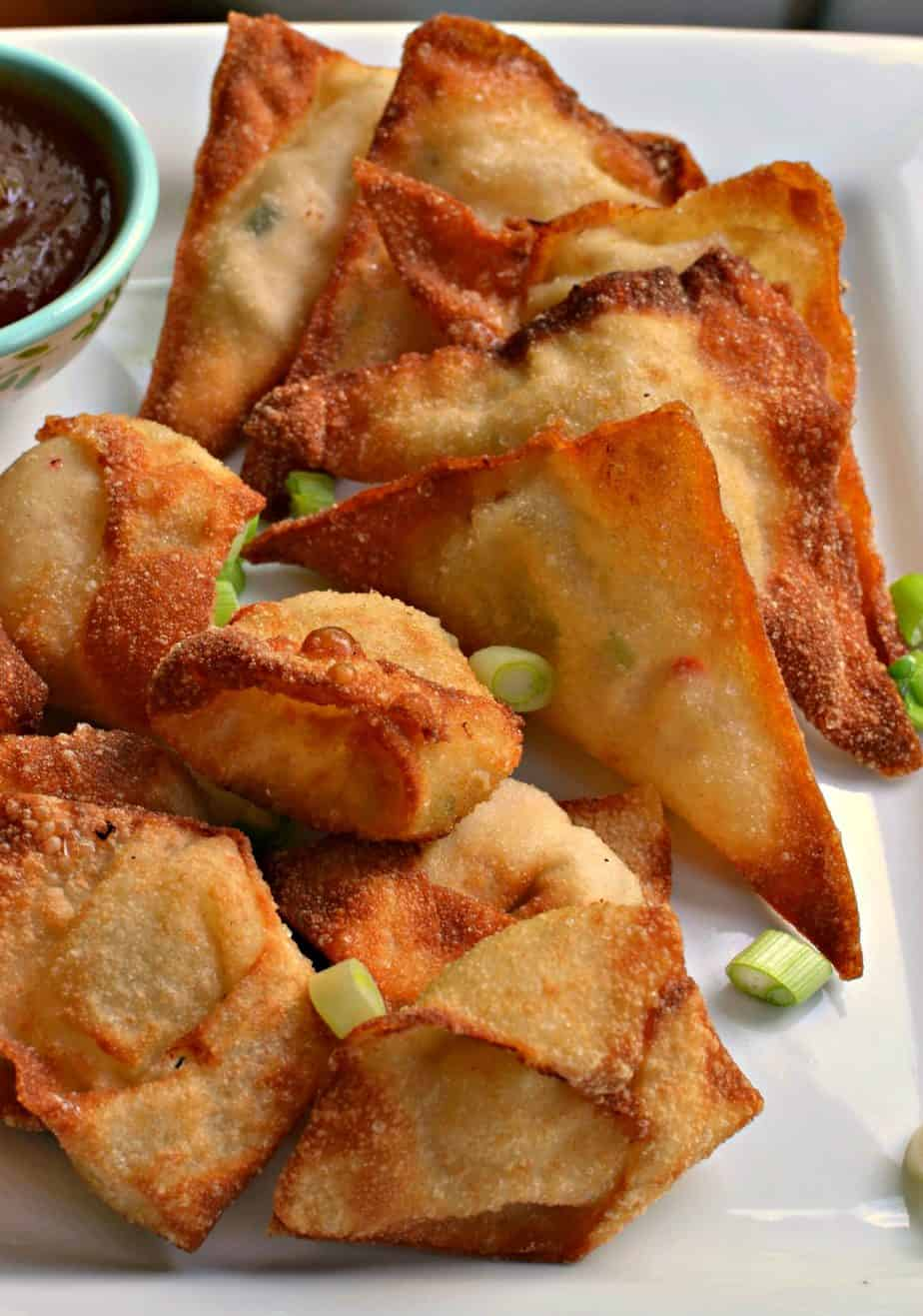 Crab Rangoons are delectable crispy fried wontons stuffed with cream cheese and crab meat.