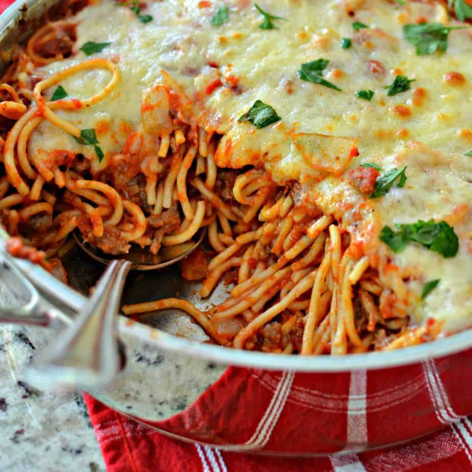 Easy Baked Spaghetti is the perfect simple dinner recipe that feeds a crowd and gets dinner on the table fast!
