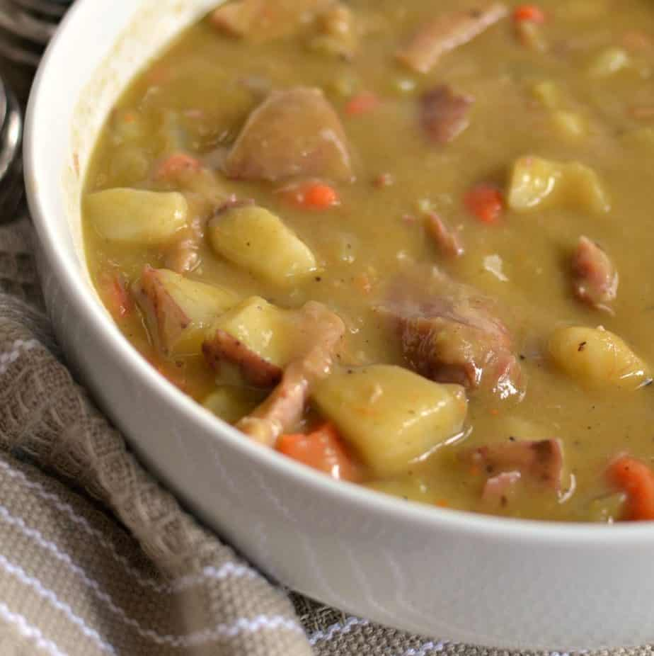 Delectable Split Pea Soup Recipe has tender potatoes, carrots and ham hocks for a rich, savory soup