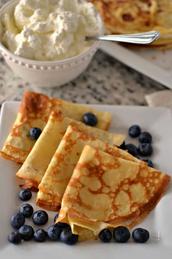 Sprinkle these easy crepes with powdered sugar and drizzle with warm maple syrup