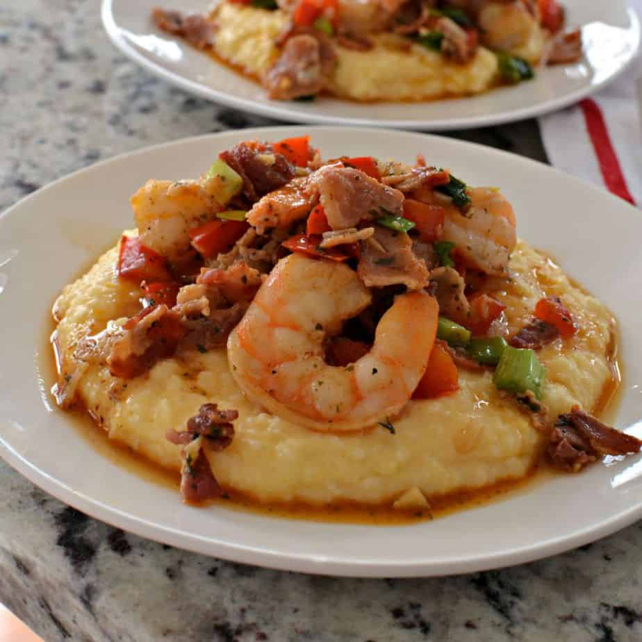 Louisiana style shrimp served over cheesy grits