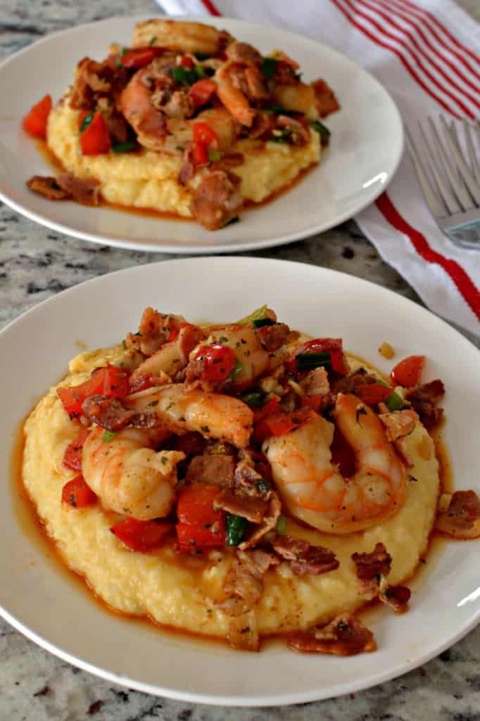 Shrimp cooked with creole seasoning, red pepper, green onions, crisp bacon and garlic over a bed of creamy cheddar grits.