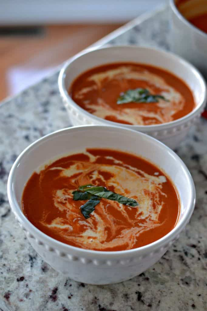 Serve this homemade tomato bisque with a drizzle of cream, topped with fresh basil