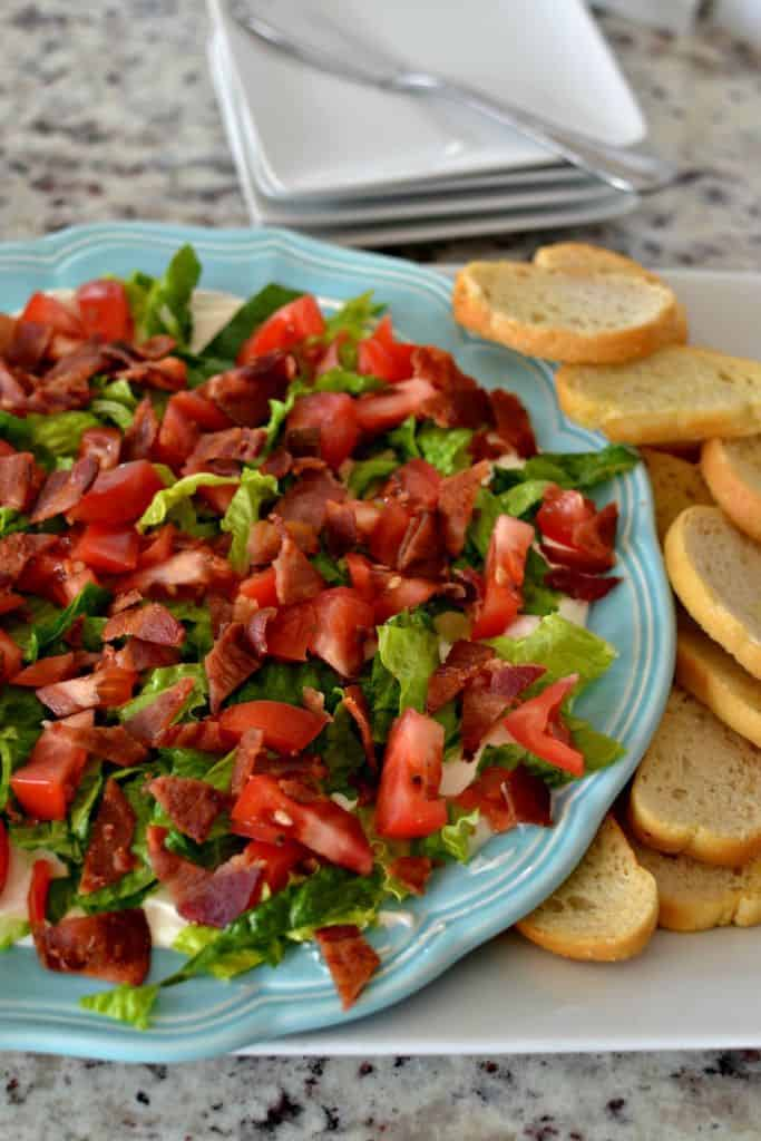 BLT Dip is best paired with fresh baked crostini for a delicious party appetizer