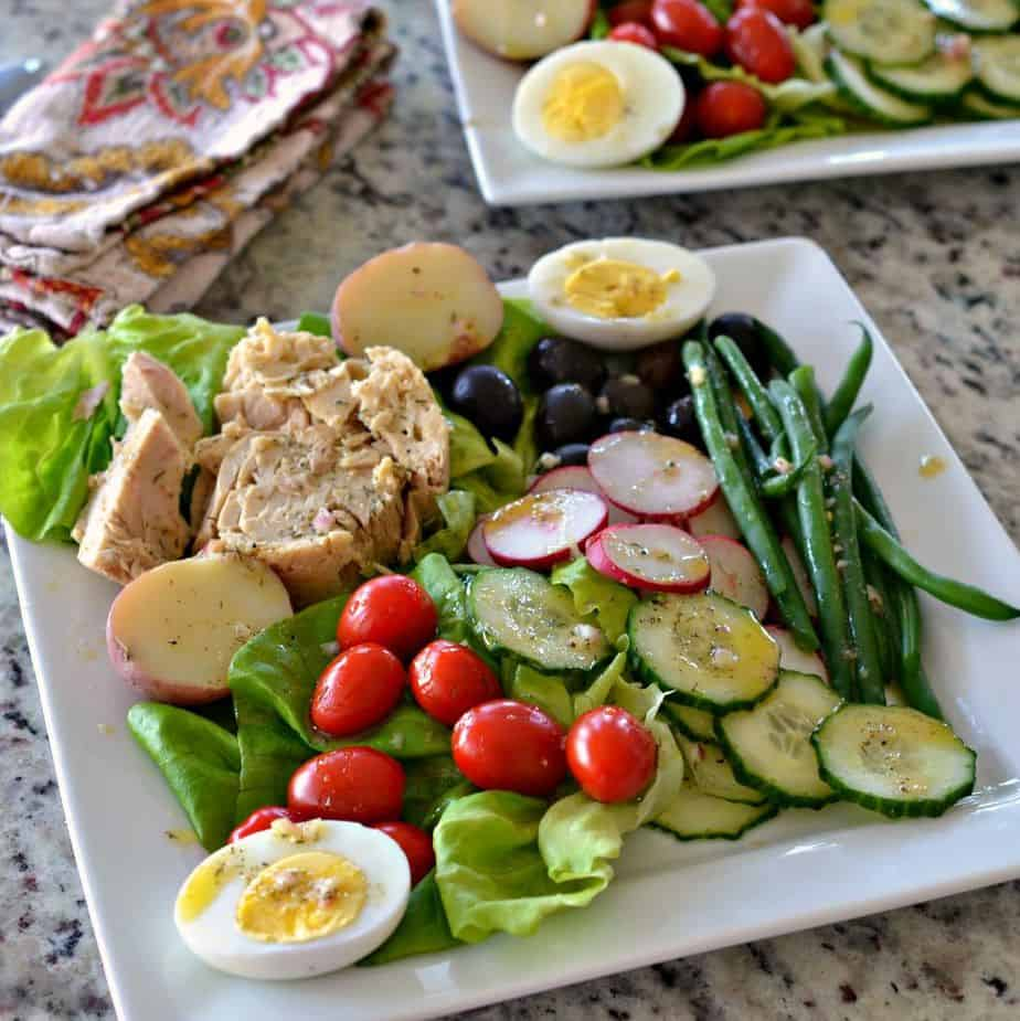 Nicoise Salad is a cornucopia of vegetables, Nicoise olives, red potatoes, eggs and tuna with a light mustard vinaigrette.