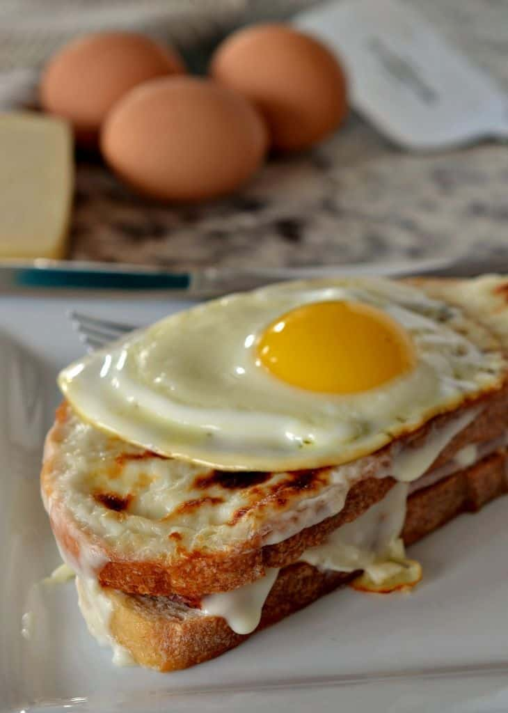 A perfectly fried egg tops this Croque Madame sandwich