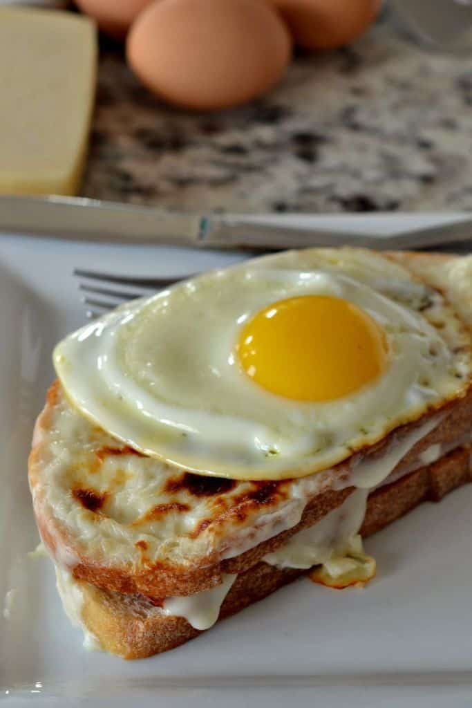 A perfect fried egg atop a Croque Madame sandwich with ham, cheese and a cream sauce