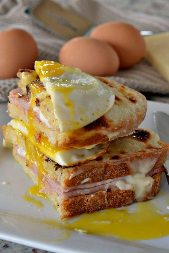 Croque Madame is composed of crisp bread, ham, cheese, and a delicious fried egg