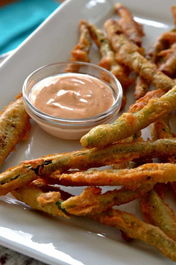 Crispy Fried Green Beans are dipped in my easy beer batter and then flashed fried to golden perfection.
