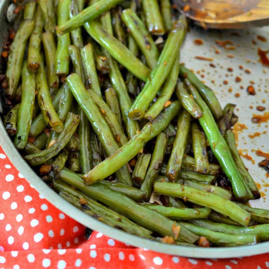 Make these delicious stir fried green beans, packed with flavorful garlic and ginger.