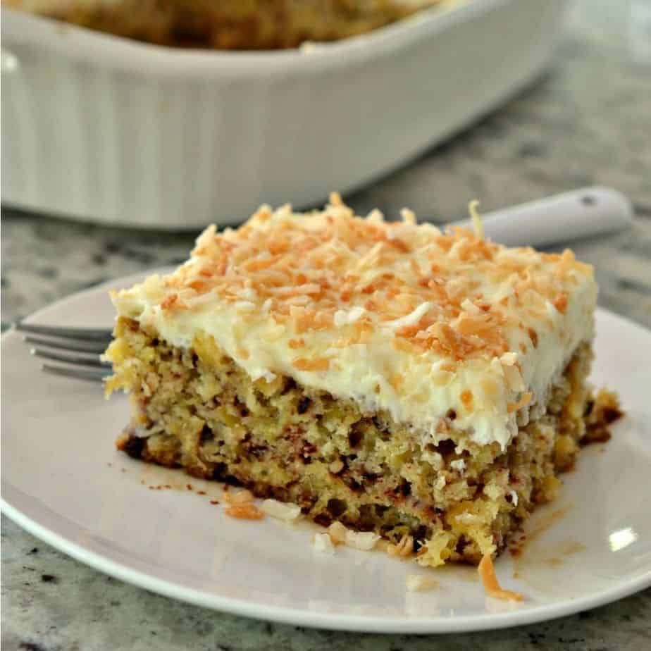 Moist sheet cake filled with pineapple, pecans, and topped with a luscious cream cheese frosting.