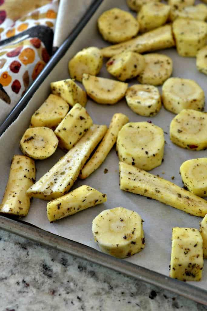 Herb-coated parsnips are ready to be roasted to a crisp golden brown