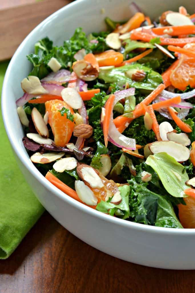 This fresh kale salad is topped with a ginger Vinaigrette for a zingy Asian flare