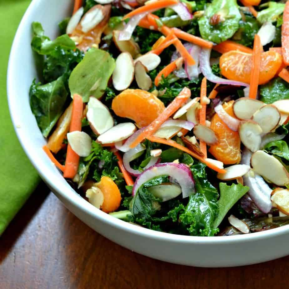 This fresh and flavorful kale salad is topped with a homemade ginger Vinaigrette for an sweet Asian zing
