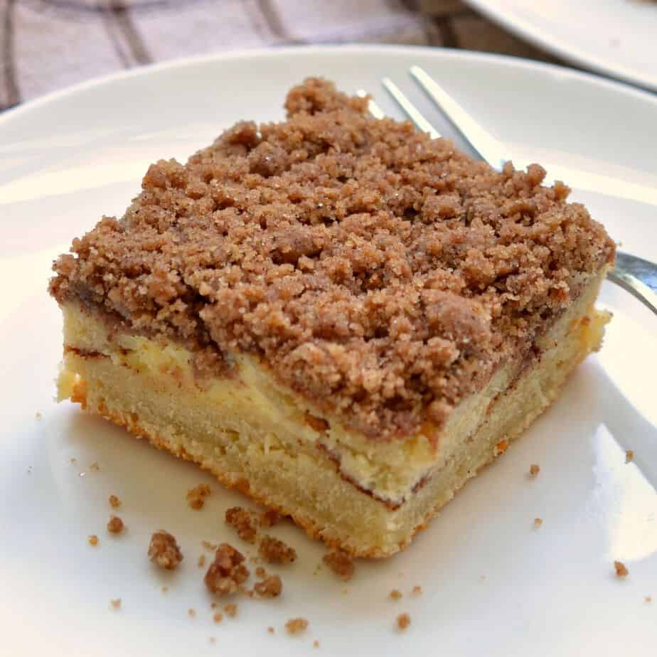 Butter cinnamon streusel crumble tops this moist cinnamon and cream cheese coffee cake
