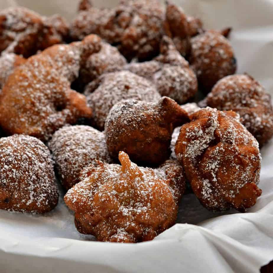 Crispy fried banana fritters coated with a light dusting of powdered sugar