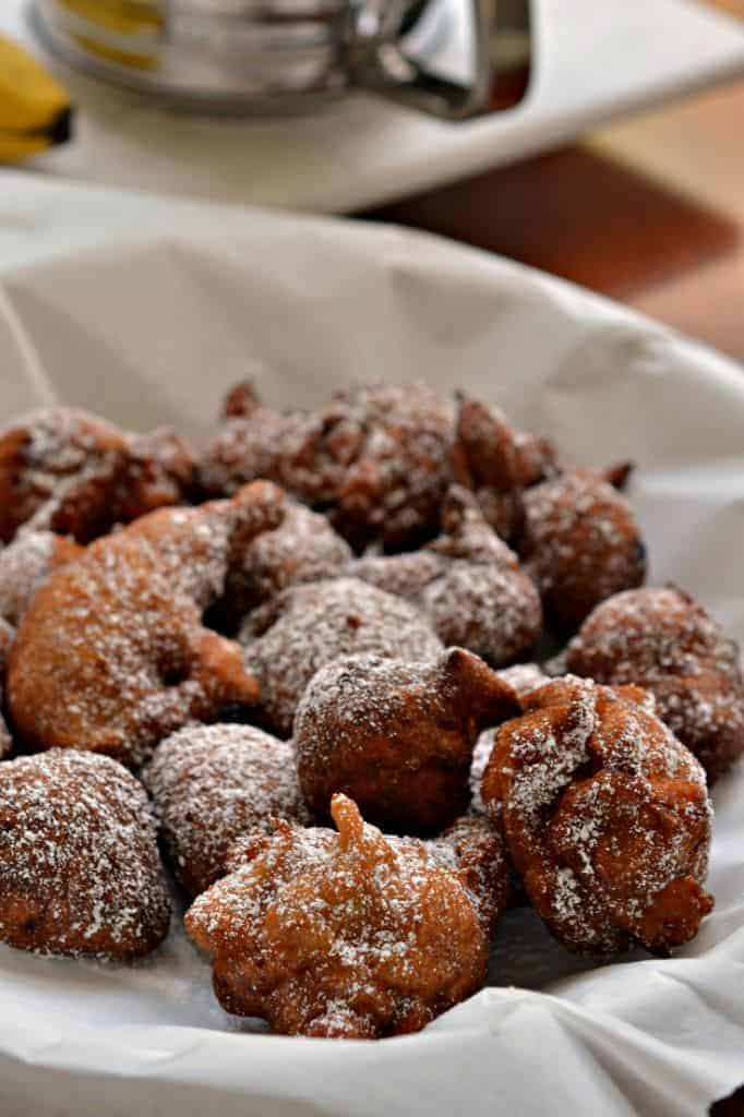 Dusted with powdered sugar, these crispy fried banana fritters are best served with some warm maple syrup