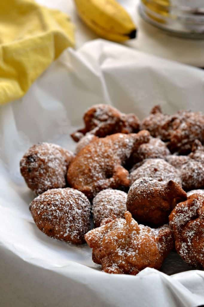 These delicious banana fritters are perfectly fried, coated with a sweet powdered sugar, and best served for breakfast with some warm maple syrup