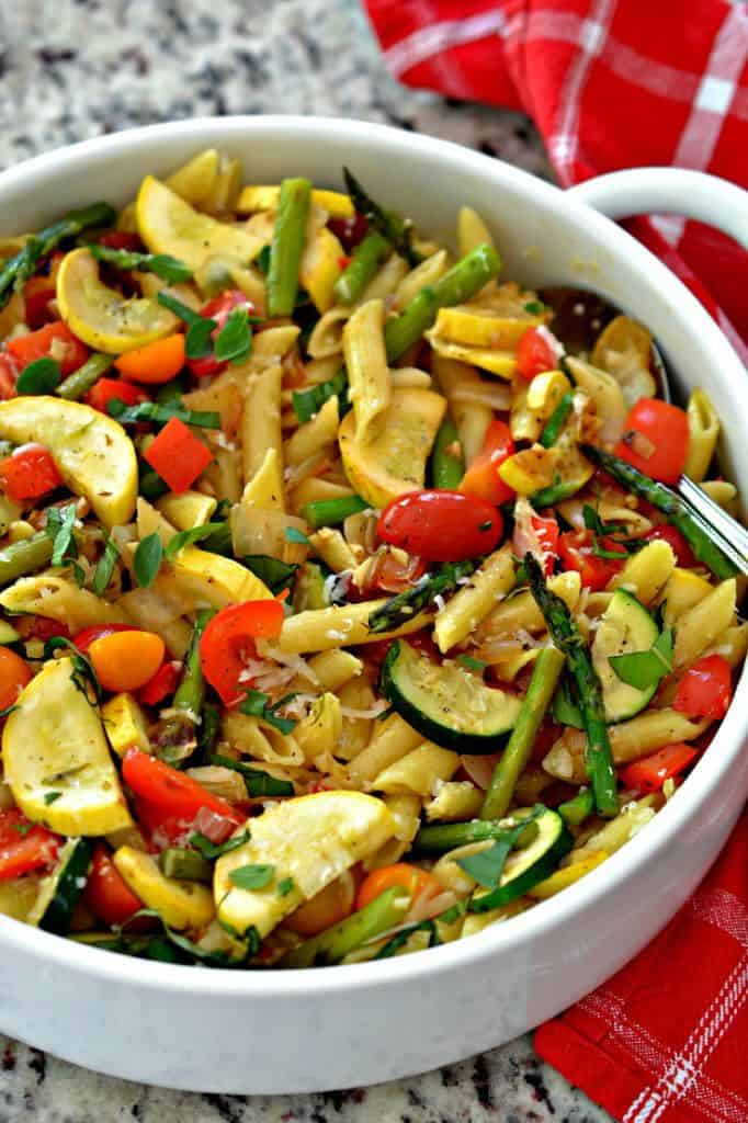 Pasta Primavera is a delicious pasta dish with flavorful vegetables and tender penne pasta.