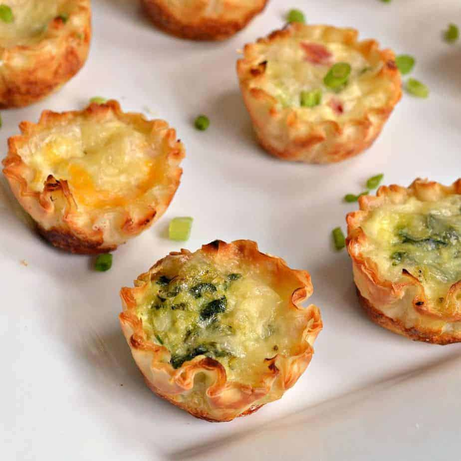 Delicious mini quiche made in flaky phyllo dough with egg, spinach, bacon, and cheese