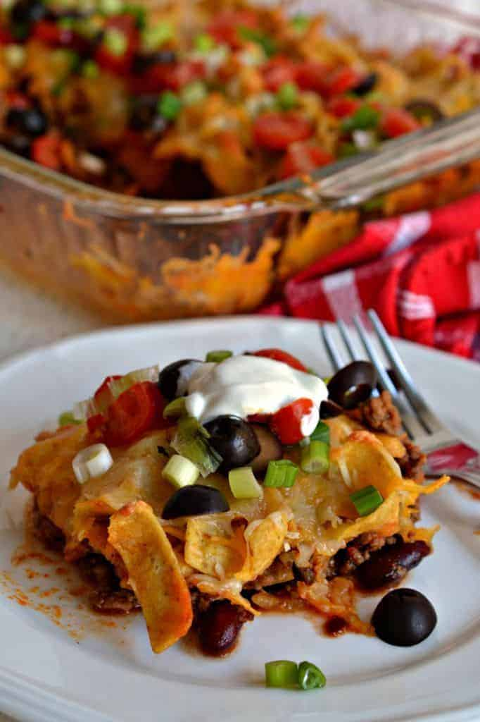 Frito Pie is a delicious taco salad with crispy fritos and your favorite taco toppings
