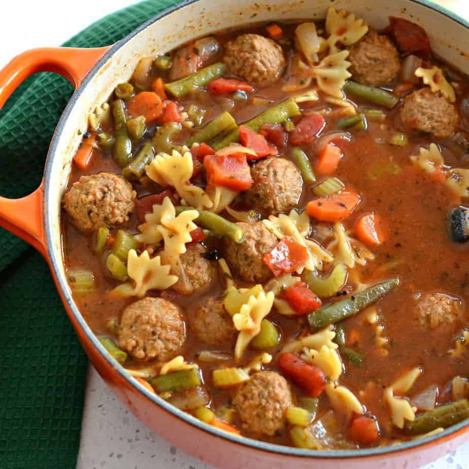 Meatball soup with carrots, celery and green beans.