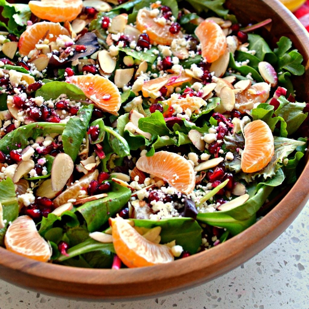 Topped with mandarin oranges, pomegranate seeds, and feta cheese, this Christmas salad is a sweet, refreshing side salad.