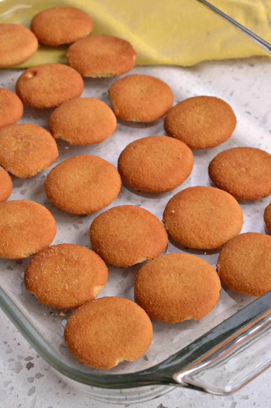 Start this homemade banana pudding recipe by lining a baking dish with a layer of vanilla wafer cookies
