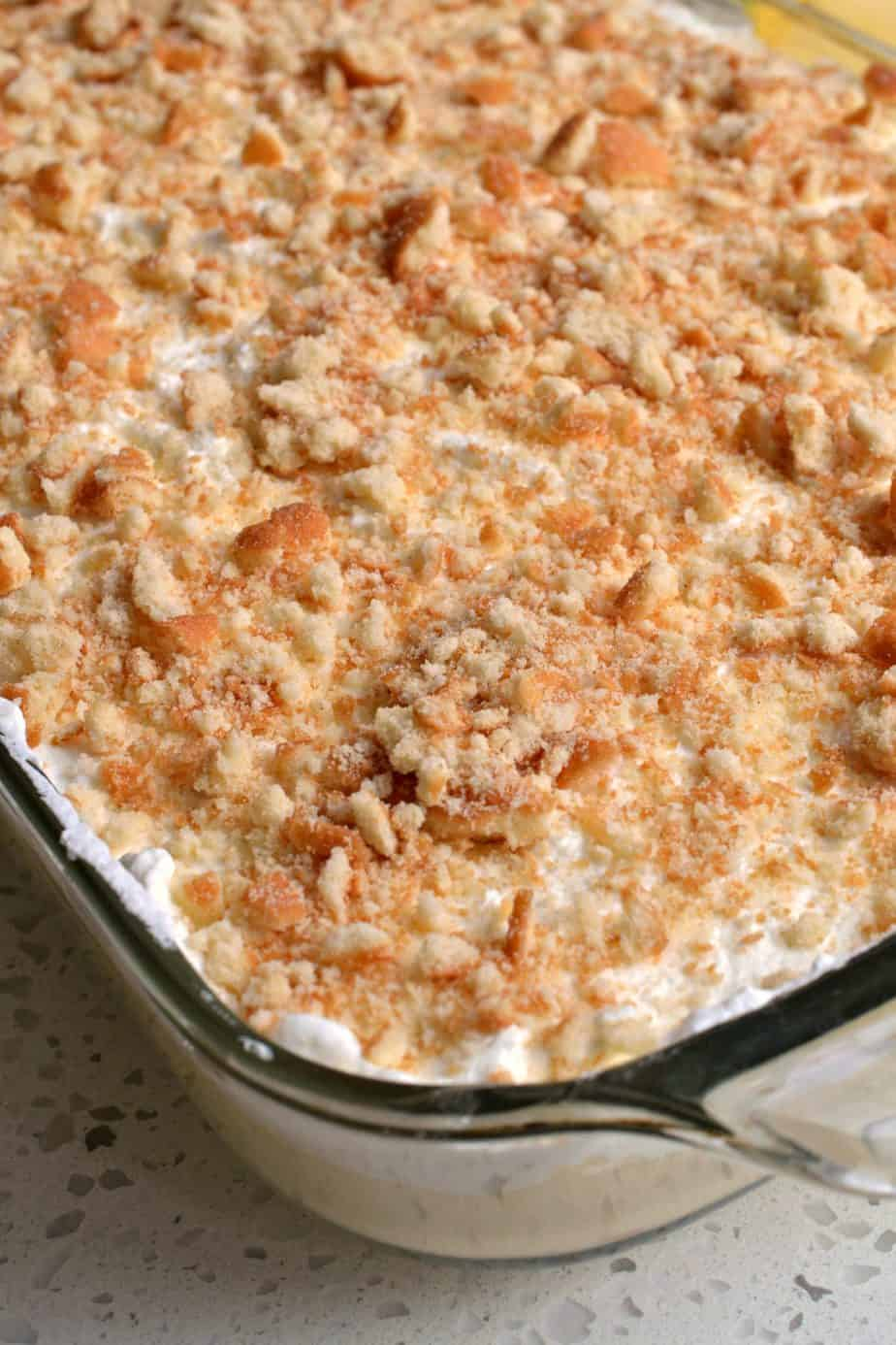 This completely from-scratch banana pudding is topped with fresh whipped cream and crumbled vanilla wafers