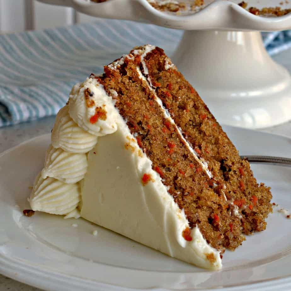 This Carrot Cake Recipe is a perfectly moist delectable two layer classic carrot cake with a pipeable cream cheese frosting.