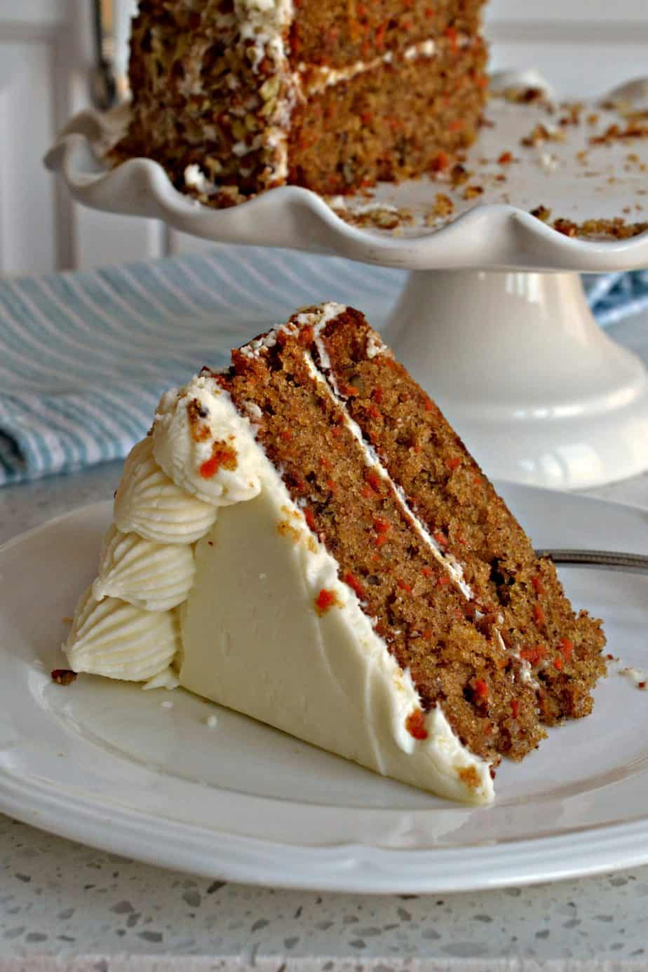 This holiday worthy Carrot Cake is a moist delectable two layer cake with classic cream cheese frosting.