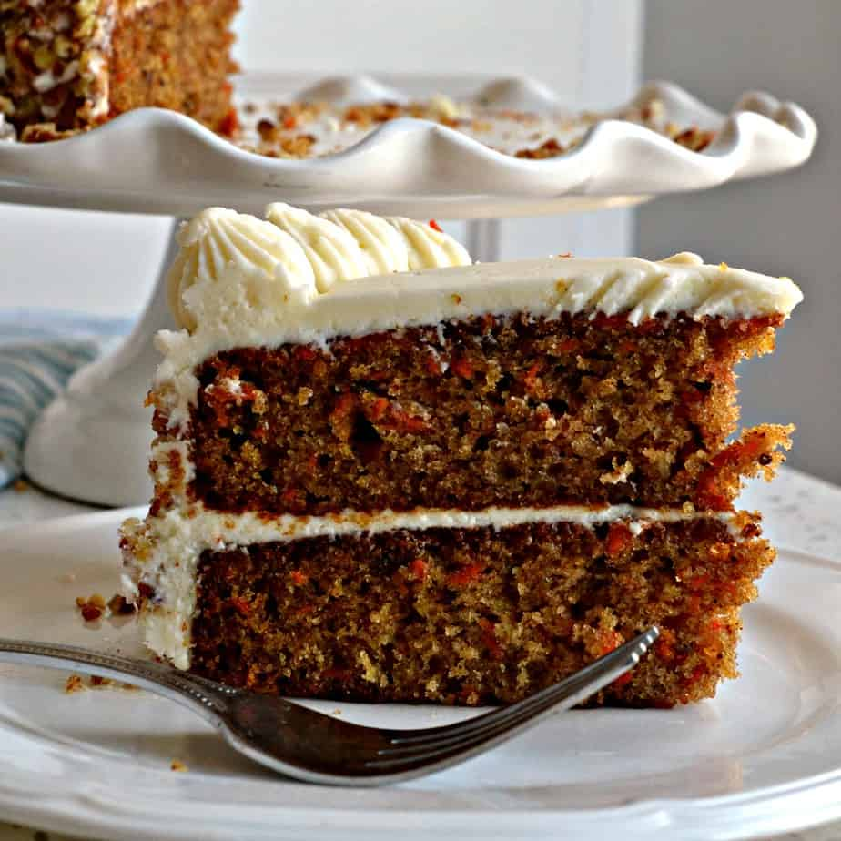 This holiday worthy Carrot Cake is a perfectly moist delectable two layer classic carrot cake with cream cheese frosting.