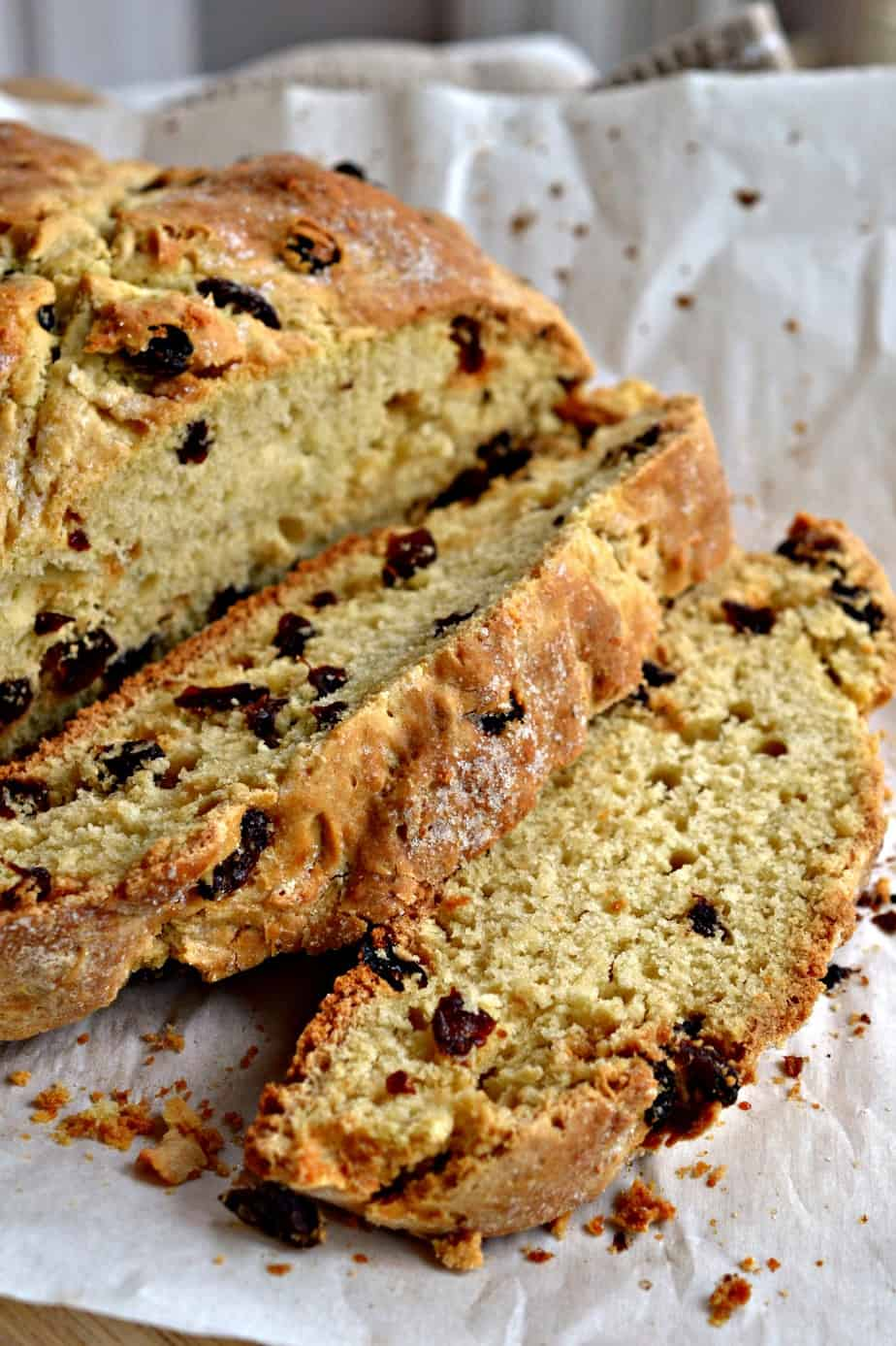 This fun easy Irish Soda Bread is prepped in under ten minutes.  It has a crispy crust with a soft sweet cake like center.