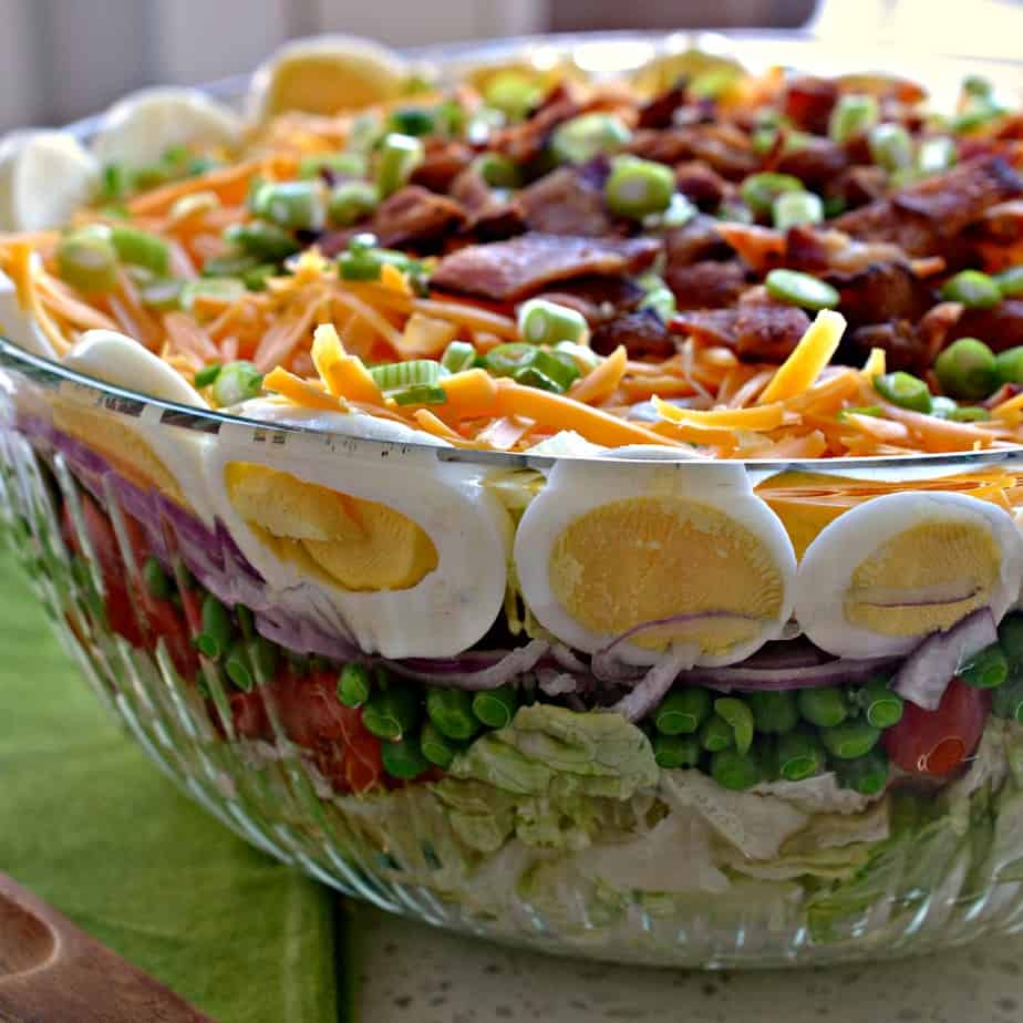 A classic seven layer salad is a perfect party dish that the whole crowd will devour