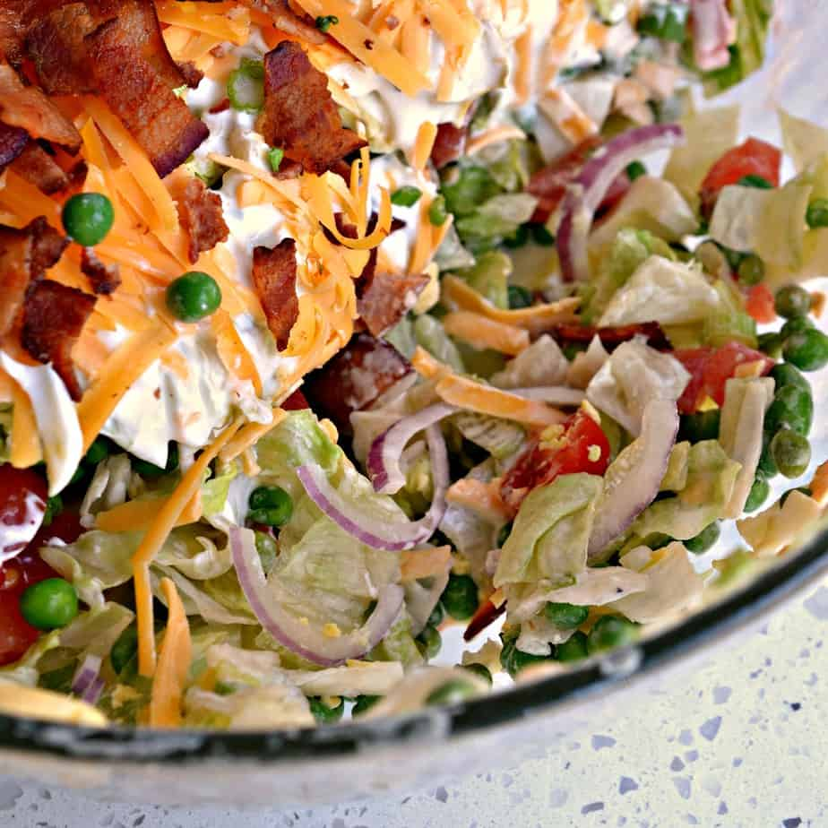 Seven layer salad is perfect for summer parties, potlucks, and get togethers