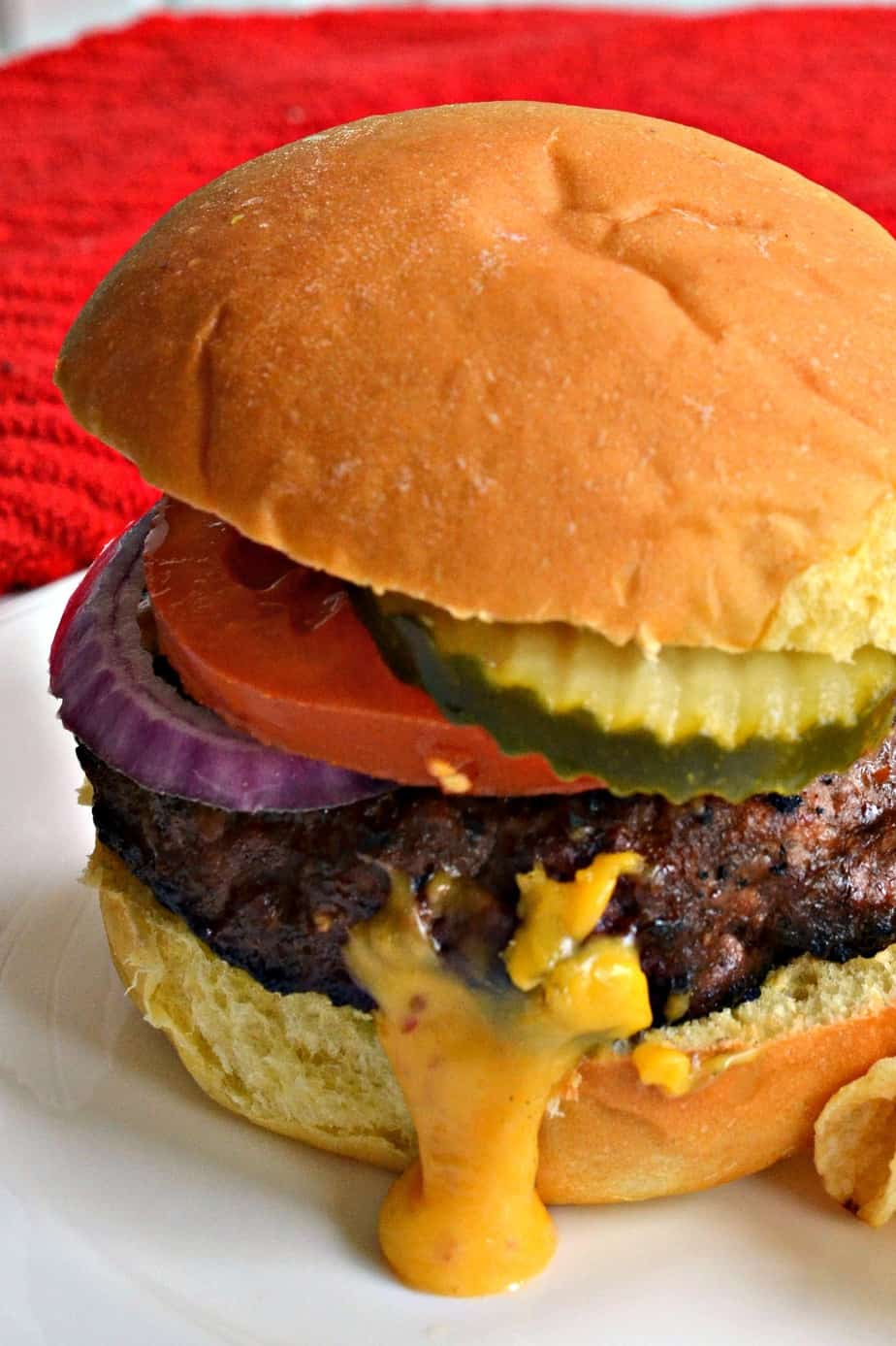 A Juicy Lucy is a juicy grilled beef burger with a pocket of ooey gooey melted cheese.