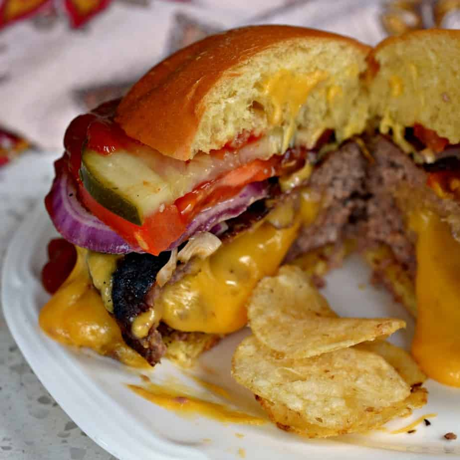 A Juicy Lucy is a juicy beef burger with a pocket of ooey gooey melted American Cheese.