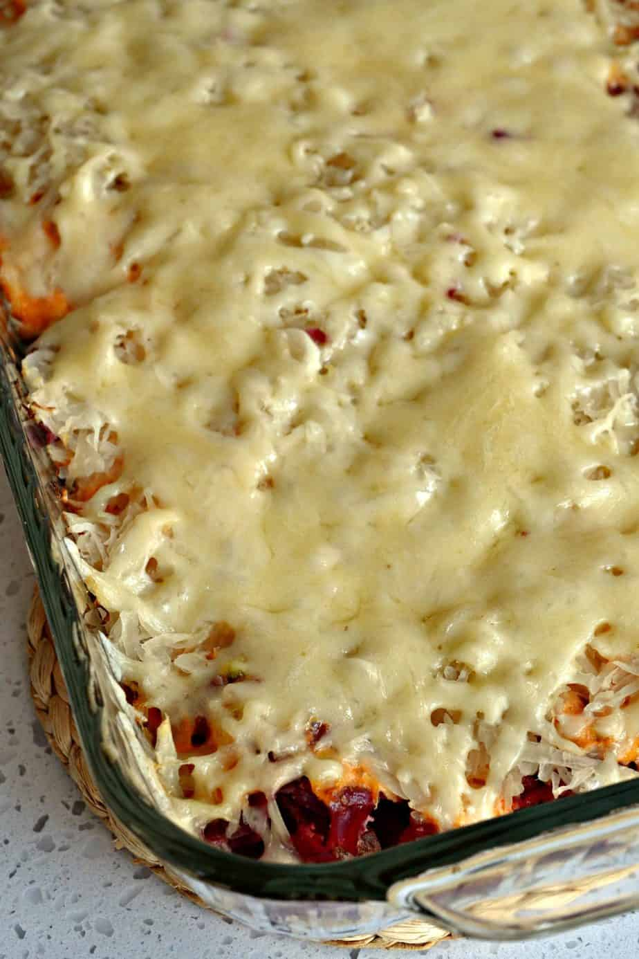 This Reuben Casserole is topped with creamy melted swiss cheese on top of layers of sauerkraut and corned beef