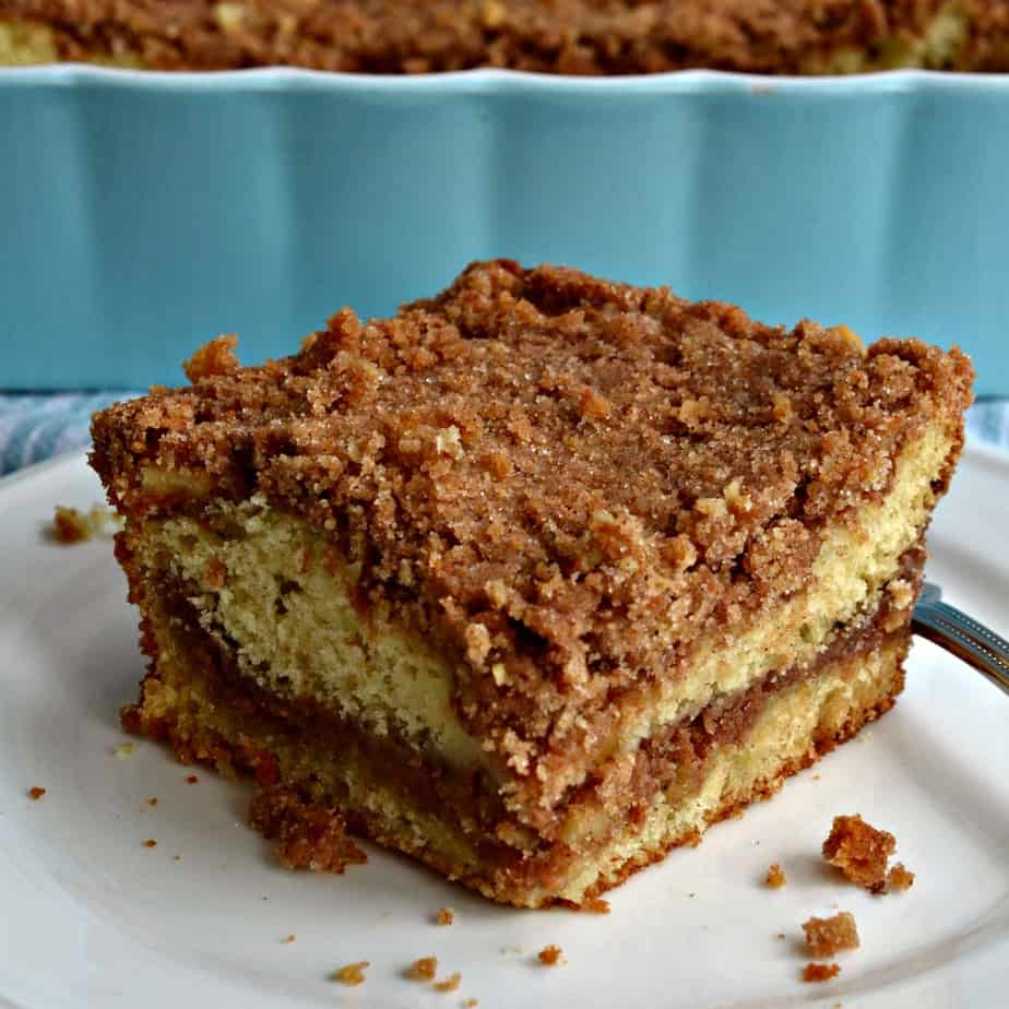 Sour Cream Coffee Cake is a rich decadent buttery cake with a generous layer of walnut streusel through the center.