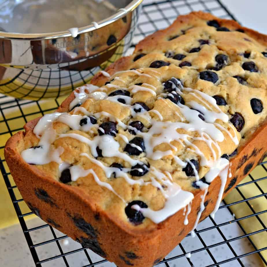 An easy sweet quick bread made with fresh lemon juice and plump blueberries all topped with a two ingredient lemon glaze.