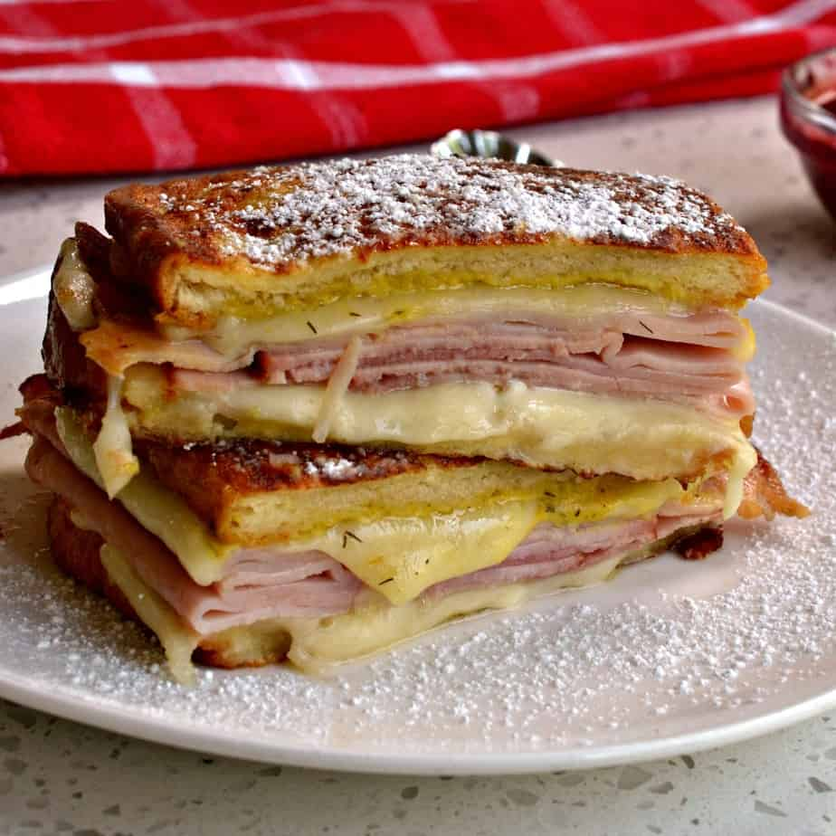 This tasty sandwich is layered with ham, turkey and cheese between bread that has been dipped in egg batter and pan fried.